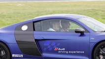 Bastian Schweinsteiger and Thomas Müller in the Audi R8