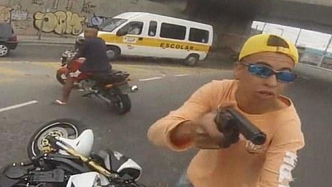 Biker jacked at gunpint before thief shot dead