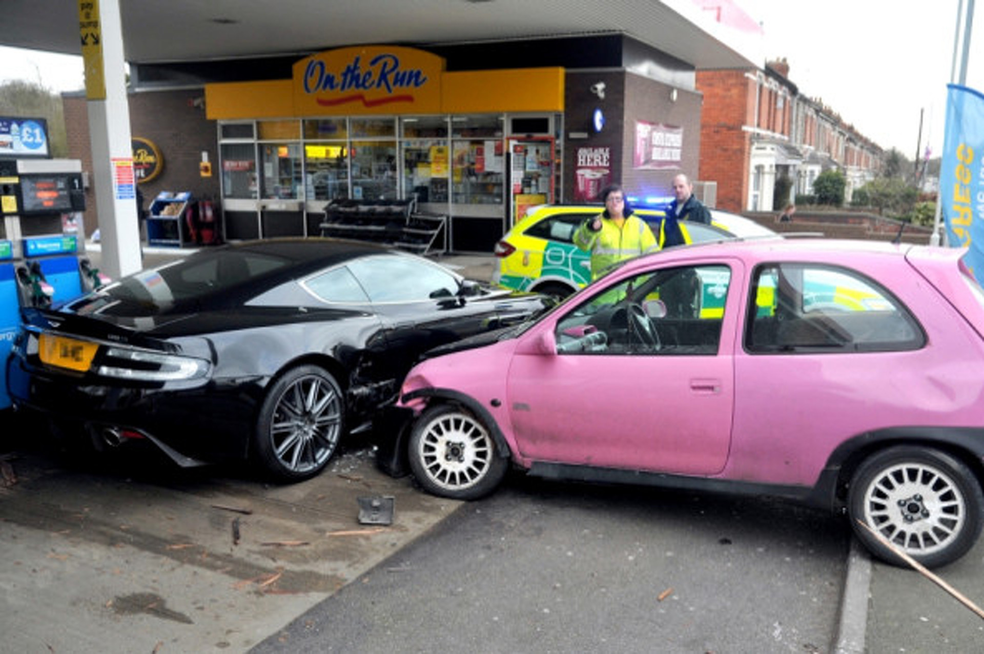 Pink 500-Pound Hatchback Crashes into Aston Martin in UK
