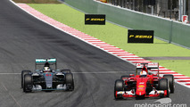 Sebastian Vettel, Ferrari SF15-T and Lewis Hamilton, Mercedes AMG F1 W06 battle for position