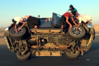 Team of Saudis Change Tires...While Vehicle is in Motion! [Video]