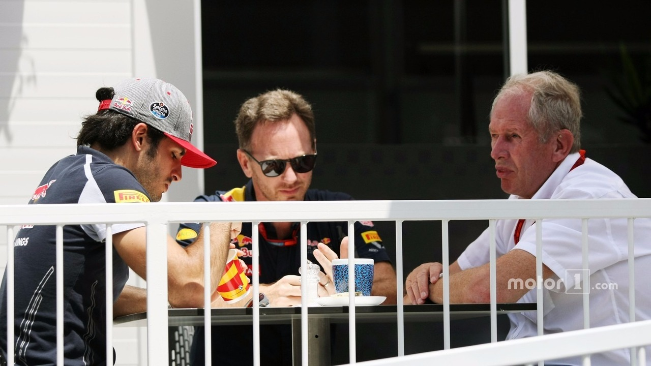 (L to R)- Carlos Sainz Jr., Scuderia Toro Rosso with Christian Horner, Red Bull Racing Team Principal and Dr Helmut Marko, Red Bull Motorsport Consultant