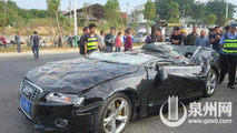 Audi S5 flattened by container - passengers somehow escape