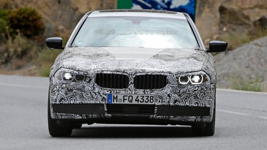 2017 BMW 5-Series plug-in hybrid spied partially showing production headlights and taillights