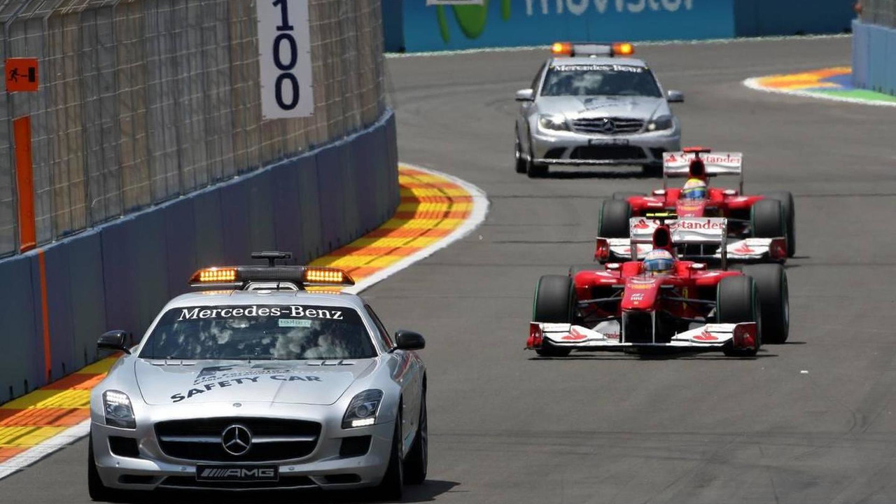 The medical and safety car are sent out after the crash of Mark Webber (AUS), Red Bull Racing, as they pass Fernando Alonso (ESP), Scuderia Ferrari, European Grand Prix, Sunday Race, 27.06.2010 Valencia, Spain