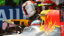 Race winner Max Verstappen celebrates in parc ferme with third placed Sebastian Vettel