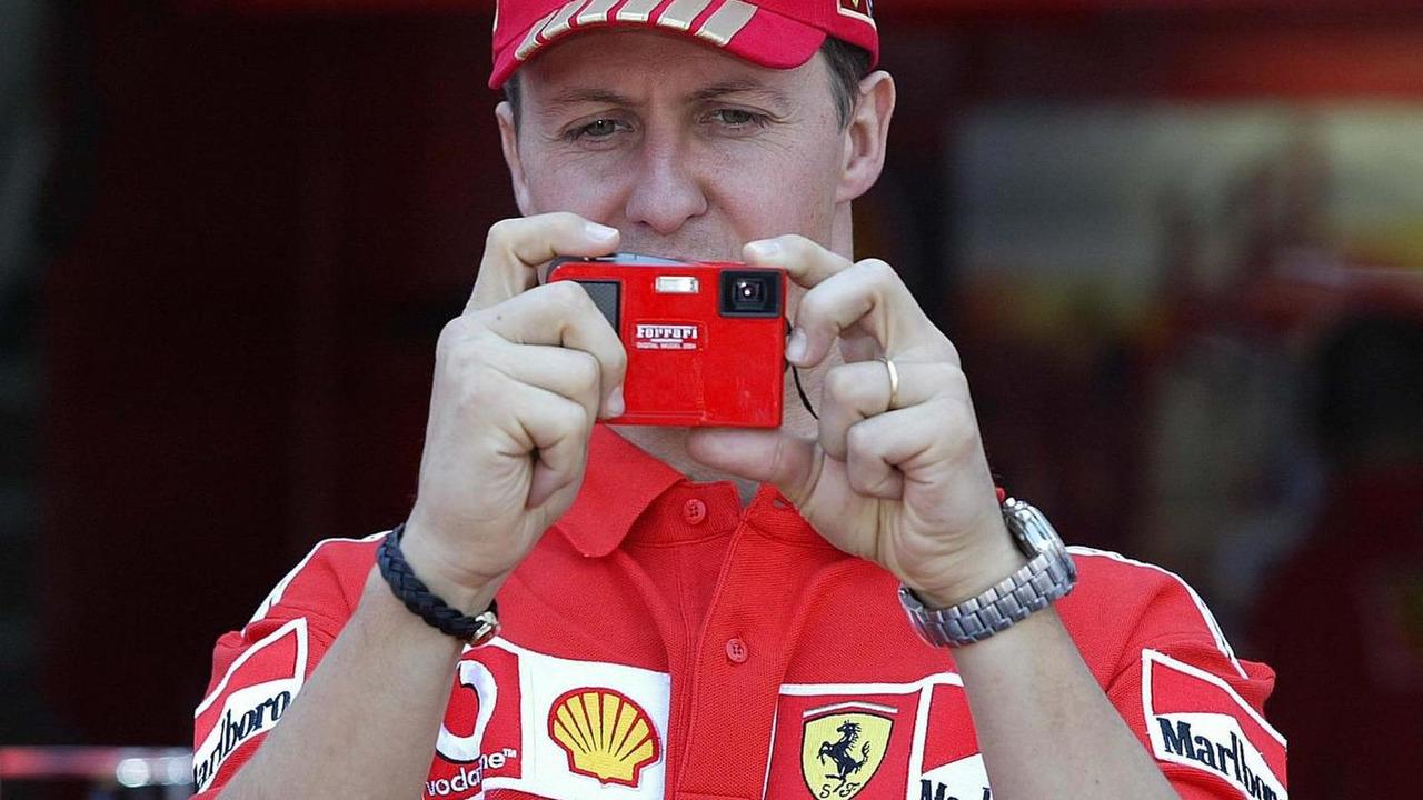 Michael Schumacher takes picture with new Ferrari Olympus digital camera 19.05.2004 Monaco Grand Prix