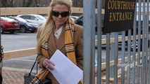 Patricia Driscoll leaves the Kent County family courthouse after a hearing regarding assault charges filed against Kurt Busch