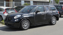 Alfa Romeo SUV spied hiding underneath a Fiat 500L body