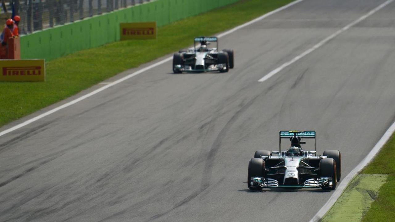 Nico Rosberg (GER) leads team mate Lewis Hamilton (GBR) who exits the pits, 07.09.2014, Italian Grand Prix, Monza / XPB