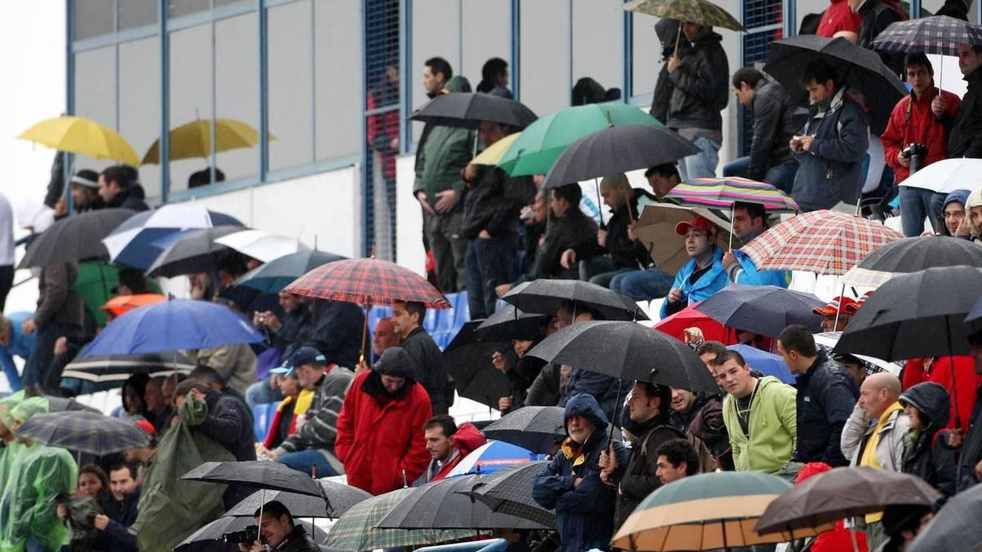 Fans carry umbrellas into Spa for thrilling race