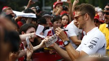 Jenson Button, McLaren signs autographs for fans