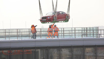 Bentley airlifts a V8 Continental GT coupe over Munich 08.02.2012