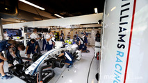 Engineers work on the car of Valtteri Bottas, Williams FW38