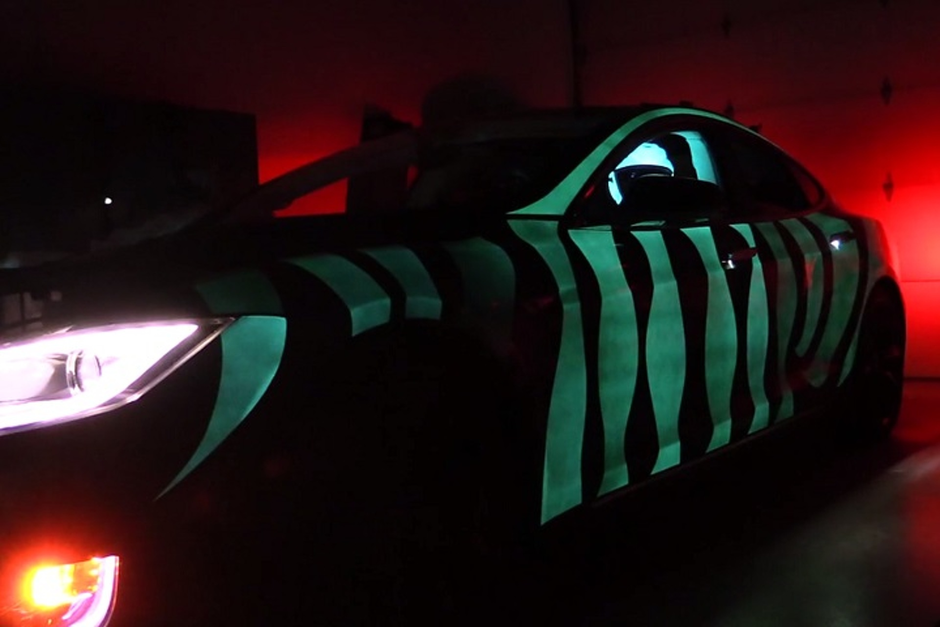 Glow In The Dark Tesla Looks Like 'Tron' Light Cycle [Video]
