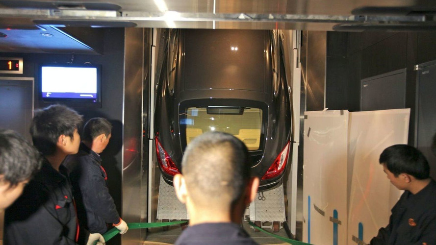Porsche Panamera stands straight up in the freight elevator