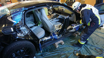 Porsche Panamera being cut apart from the fire brigade
