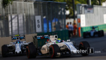 Felipe Massa, Williams FW38, leads Valtteri Bottas, Williams FW38