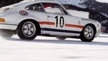 Porsche pulling skiers on frozen lake