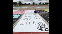 High school students paint and personalize parking spots