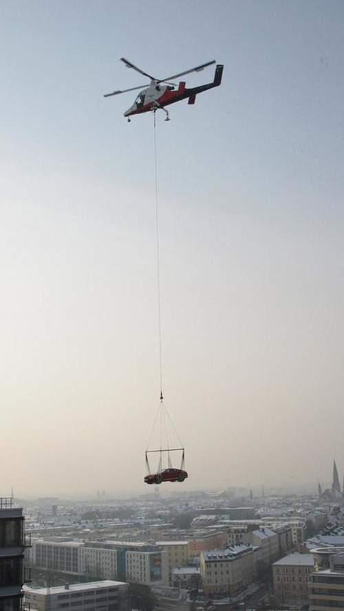 Bentley airlifts a V8 Continental GT coupe over Munich [video]