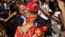 Michael Schumacher celebrates pole position with Luca di Montezemolo