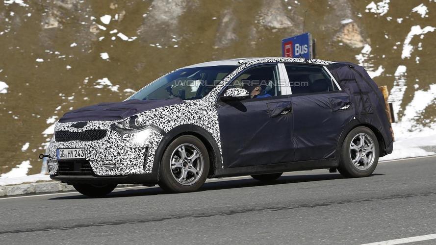 Kia Niro prototype spied with heavy camouflage testing in the Alps