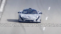 McLaren P1 spied with less camouflage
