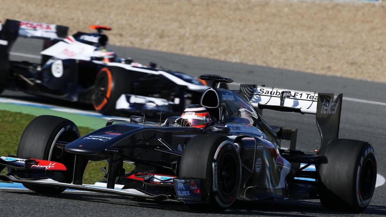 Nico Hulkenberg leads Pastor Maldonado 06.02.2013 Formula One Testing Jerez Spain
