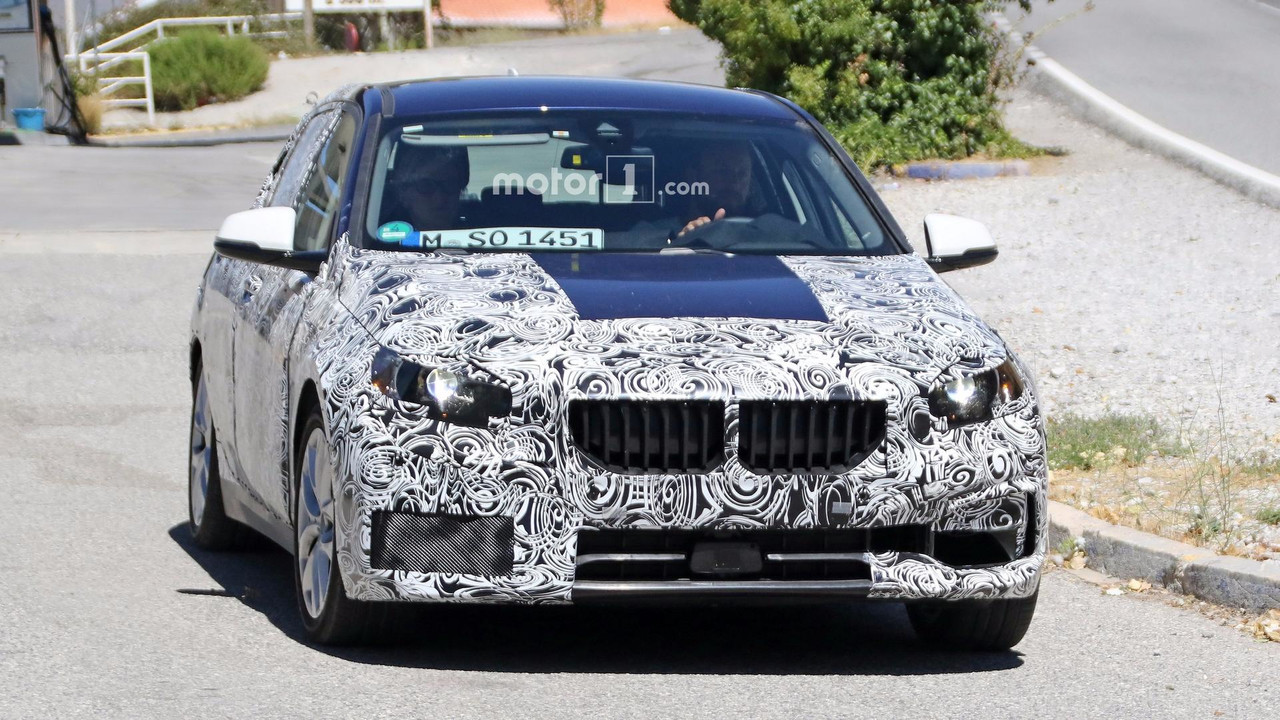 2019 bmw 1 series spied with less camo to reveal front grille. Black Bedroom Furniture Sets. Home Design Ideas