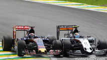 Sergio Perez, Sahara Force India F1 VJM08 and Max Verstappen, Scuderia Toro Rosso STR10 battle for position