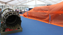 Bloodhound SSC show car next to the EJ200 jet engine waiting to be unveiled at Farnborough on 19.07.2010