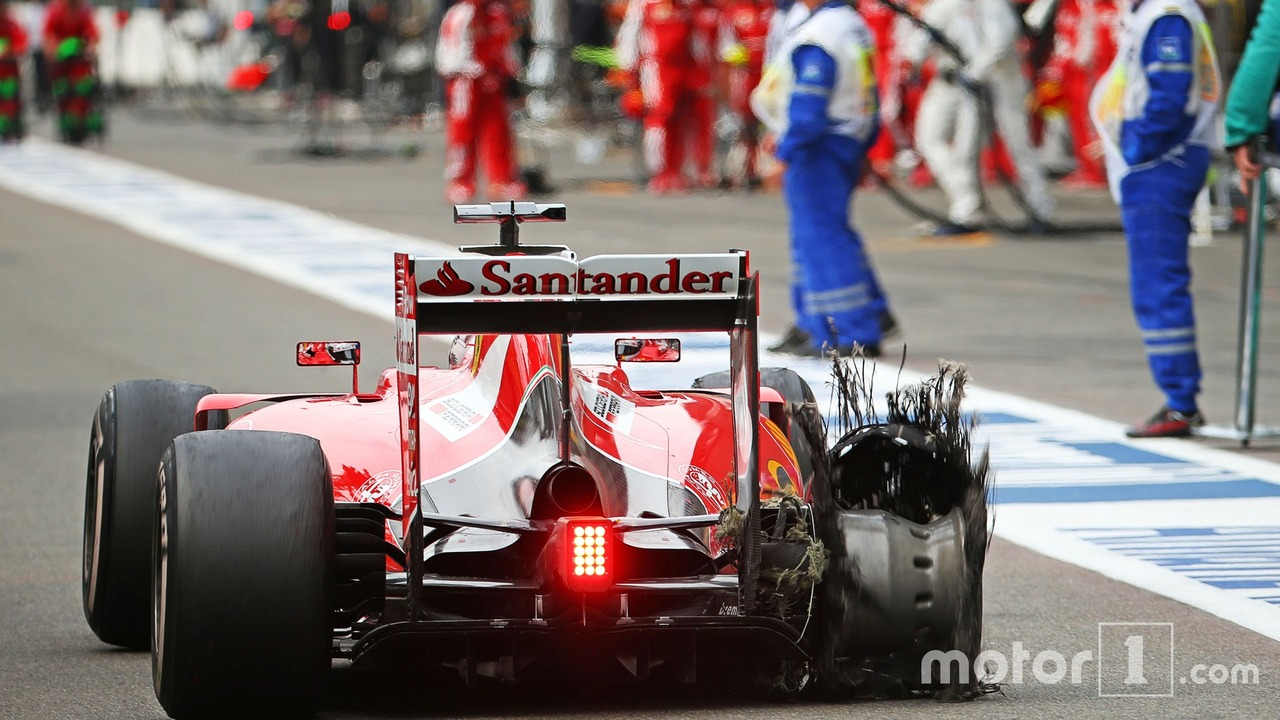 Sebastian Vettel, Ferrari SF15-T heads to the pit late in the race with a puncture