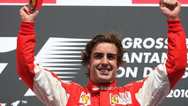 Frnando Alonso celebrates his controversial victory at Hockenheim