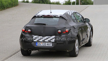 Opel Astra GTC coupe spied out in public for the first time