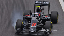 Jenson Button, McLaren MP4-31 locks up under braking