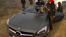 Lara Stone and Mercedes SL roadster on set 13.01.2012