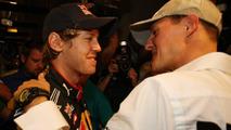 Sebastian Vettel (GER), Red Bull Racing is congratualted by Michael Schumacher (GER), Mercedes GP Petronas - Formula 1 World Championship, Rd 19, Abu Dhabi Grand Prix, 14.11.2010