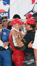 Victory lane- Dan Wheldon celebrates with Michael Andretti