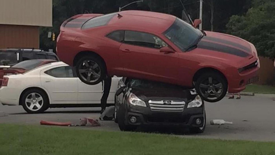 Chevrolet Camaro inexplicably ends on top of Subaru Outback and stays there