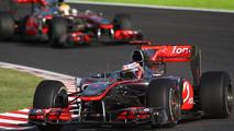 Jenson Button (GBR), McLaren Mercedes leads Lewis Hamilton (GBR), McLaren Mercedes - Formula 1 World Championship, Rd 16, Japanese Grand Prix, 10.10.2010 Suzuka, Japan