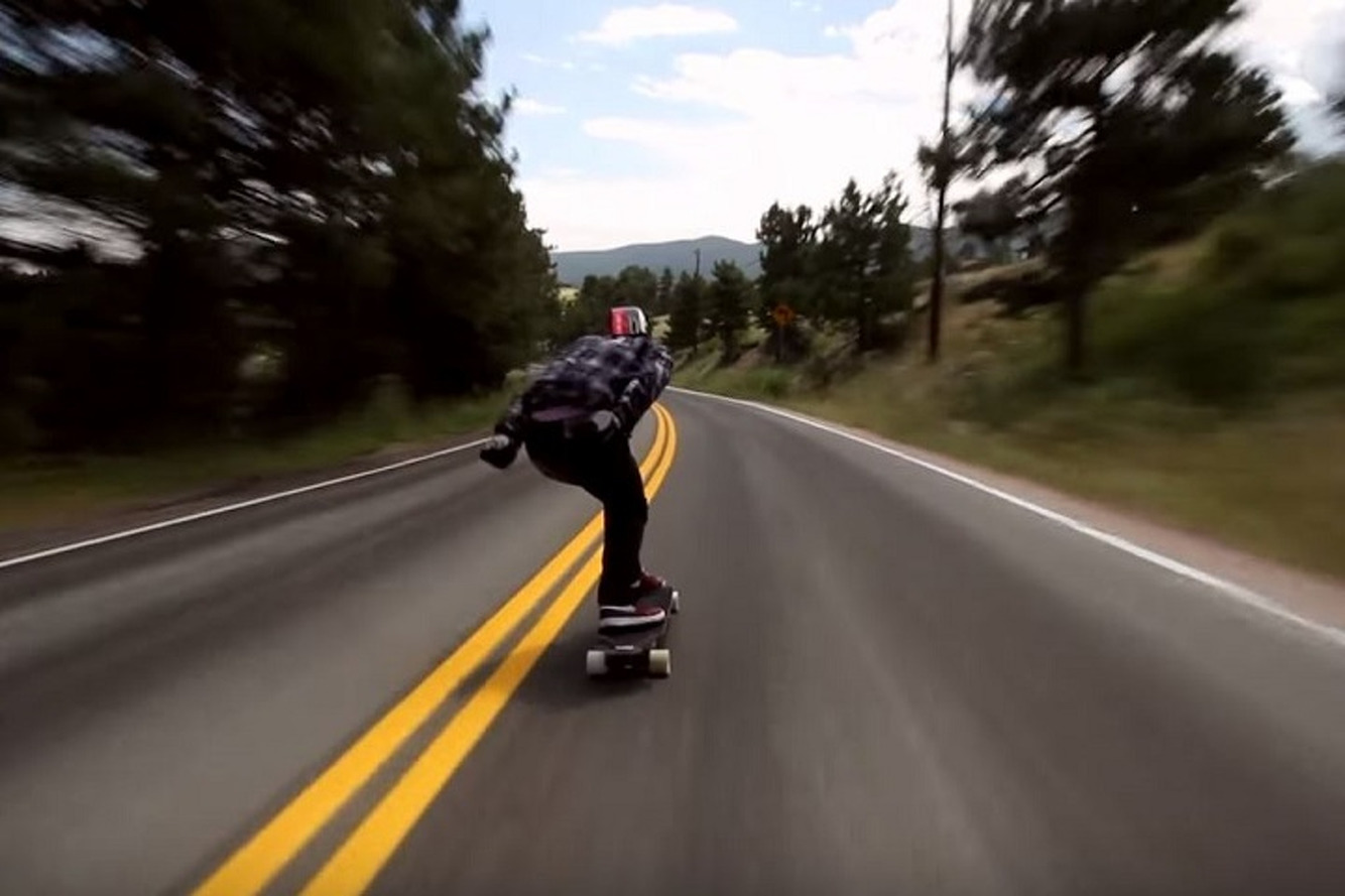 Watch an Insane 70-MPH Longboard Ride Down a Mountain