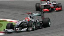 Michael Schumacher (GER), Mercedes GP and Jenson Button (GBR), McLaren Mercedes, Spanish Grand Prix, 09.05.2010 Barcelona, Spain