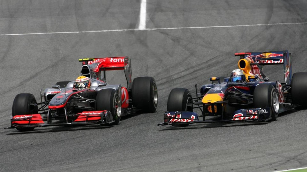 Sebastian Vettel (GER), Red Bull Racing and Lewis Hamilton (GBR), McLaren Mercedes goes out of the pits - Formula 1 World Championship, Rd 5, Spanish Grand Prix
