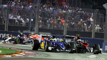 Marcus Ericsson, Sauber C34 and Jenson Button, McLaren MP4-30 battle for position