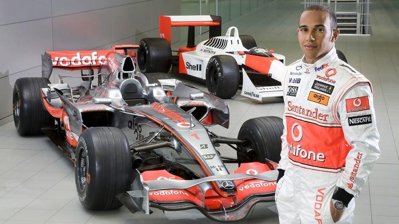 Lewis Hamilton with 2008 McLaren MP4-23 and 1988 McLaren-Honda MP4/4 turbo