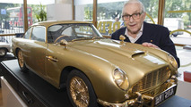 Sir Ken Adam - Production Designer - Goldfinger with gold plated Aston Martin DB5 scale model