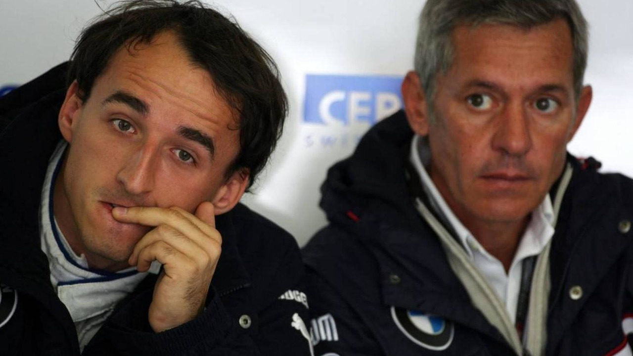 Robert Kubica (POL), BMW Sauber F1 Team and his manager, Daniele Morelli, German Grand Prix, 10.07.2009 Nürburg, Germany