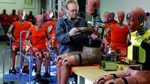 A Porsche employee in Weissach prepares crash test dummies for use 23.11.2010
