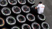 McLaren mechanic with Pirelli tyres 22.08.2013 Belgian Grand Prix
